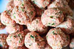 Small raw meatballs Stock Image