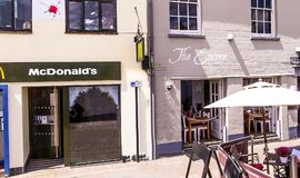 Small reataurant in vintage british building at the center of old town. Royalty Free Stock Photography