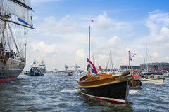 Small recreation boat is sailing during the great nautical event SAIL 2015. Royalty Free Stock Photos