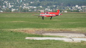 Small red airplane before take-off. Old plane at the airport. Engine of an old aircraft stock footage
