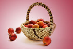 Small red apples in a basket. Royalty Free Stock Photo