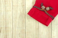 Small red bag on wood pattern background Royalty Free Stock Photos
