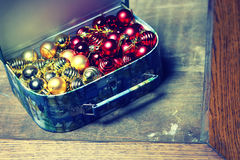 Small red ball in a box Royalty Free Stock Photos