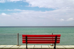 Small red bench overlooking the Aegean sea Stock Photos