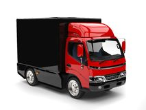 Small red and black box truck. Isolated on white background Stock Photography