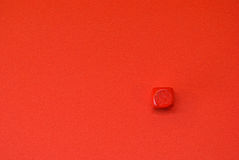 Small red block on red background Stock Photos