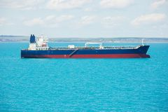 Small oil product tanker at anchor. Stock Photography
