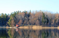 Small red boat house Stock Photography
