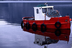 Small red fishing boat, in Norway Royalty Free Stock Photo