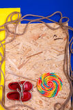 Small red boat shoes, lollipop Stock Image
