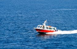 Small Red Boat Speeding Across the Mediterranean sea.  royalty free stock images