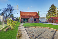 Small red brick home on a sunny day. Northwest, USA Stock Image