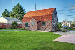 Small red brick home on a sunny day. Northwest, USA Royalty Free Stock Photography