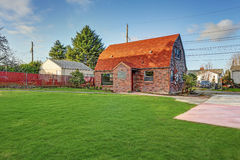 Small red brick home on a sunny day. Northwest, USA Stock Photography