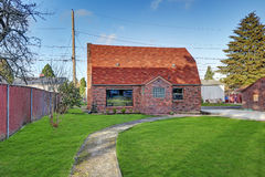 Small red brick home on a sunny day. Northwest, USA Royalty Free Stock Photos