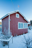 Small red cabin at winter Royalty Free Stock Photography