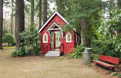 A small red chapel in a forest, Portland OR. Royalty Free Stock Photo