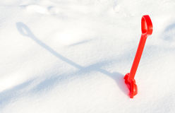 Small red children shovel into a snow Stock Photos