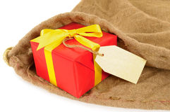 Small red Christmas gift and label inside mail delivery bag Stock Photo