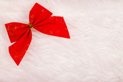 Small red Christmas ribbon on fluffy background Stock Images