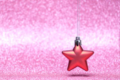 Small red Christmas star on glitter background Stock Photography