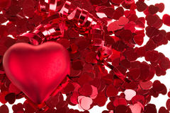 Small red confetti and big hearts Royalty Free Stock Images