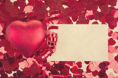 Small red confetti and big hearts in retro color Royalty Free Stock Photography