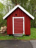Small red cottage/house Stock Images