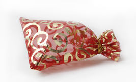 Small red decorative bag. For presents with light golden pattern and shadow Royalty Free Stock Photography