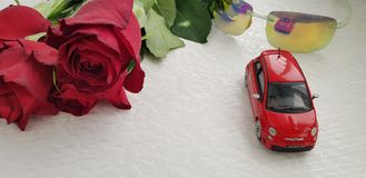 Small red Fiat 500 toy reflected in green fashionable sunglasses royalty free stock photos