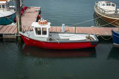 Small red fishing boat moored in harbor Royalty Free Stock Photo