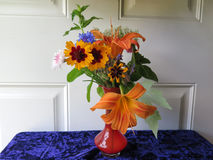 Small Red Glass Vase Wildflowers & Yellow Daylilies Greenery Royalty Free Stock Images