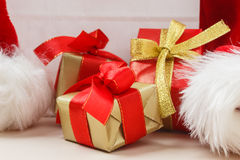 Small red and golden boxes with gifts tied bows Royalty Free Stock Photography