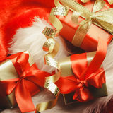 Small red and golden boxes with gifts tied bows Royalty Free Stock Photos