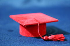 Small red graduation cap Royalty Free Stock Photos
