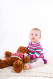 Small red hair baby girl playing with teddy bear on white backgr Stock Images