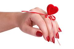A small red heart on a female hand Royalty Free Stock Photography
