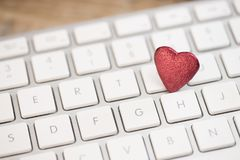 Small red heart on keyboard internet dating concept. Valentine Day Stock Photography