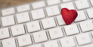 Small red heart on keyboard internet dating concept. Valentine Day Royalty Free Stock Image