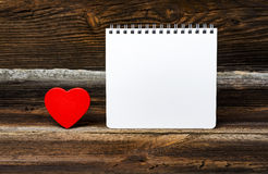 Small Red Heart With Notepad Stock Photo