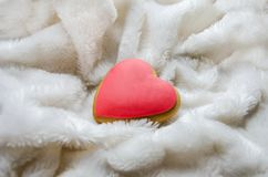 Small red heart on a white blanket royalty free stock photos