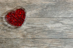 Small Red Hearts in a Heart Shaped Bowl Royalty Free Stock Photo