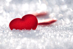 Small red hearts on snow Royalty Free Stock Photos