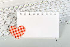 Small red hearts and sticky note Stock Image