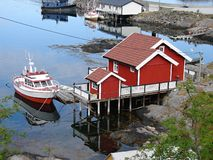 Small red house with boat in Moskenes, Lofoten Royalty Free Stock Photography