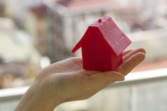 Small red house in hands Royalty Free Stock Photo