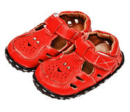 Small red leather sandals for a child Stock Photos