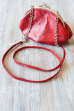 Small red leather women`s handbag Royalty Free Stock Photos