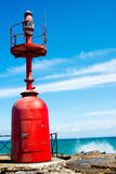 Small red lighthouse Stock Photography