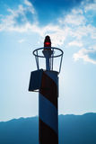Small red lighthouse lantern Royalty Free Stock Photo